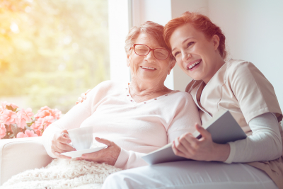 happy senior woman with caregiver